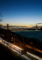 Henry Hudson Parkway traffic light streaks with George Washington Bridge in the distance