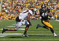 September 29 2012: Iowa Hawkeyes running back Mark Weisman (45) stiff arms Minnesota Golden Gophers defensive back Cedric Thompson (27) on an 8 yard touchdown run during the second quarter of the NCAA football game between the Minnesota Golden Gophers and the Iowa Hawkeyes at Kinnick Stadium in Iowa City, Iowa on Saturday September 29, 2012. Iowa defeated Minnesota 31-13 to claim the Floyd of Rosedale Trophy.