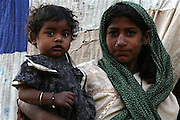 A Pakistani poor girl with her younger sisterat slum area in Karachi, Pakistan on Wednesday 21 March, 2007..Pakistan most known as an Islamic Taliban and lake of tolatent, certain youths from the middle class and upper class is finding it's way out, one foot in tredtion and the other in western way of life. Asim Hafeez/WpN