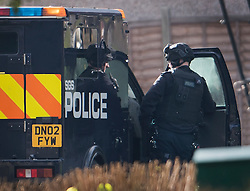 © Licensed to London News Pictures. 22/10/2016. London, UK. An armed policeman watches a house in Northolt. Police attended an address in Wood End Lane, Northolt at shortly after 00:50hrs on Friday, 21 October after a report of concerns for the occupant and hazardous items inside the property. Police believe a man is still inside the house. Photo credit: Ben Cawthra/LNP