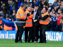 A pitch invader is escorted from the St Andrews pitch - Mandatory by-line: Paul Roberts/JMP - 29/10/2017 - FOOTBALL - St Andrew's Stadium - Birmingham, England - Birmingham City v Aston Villa - Skybet Championship