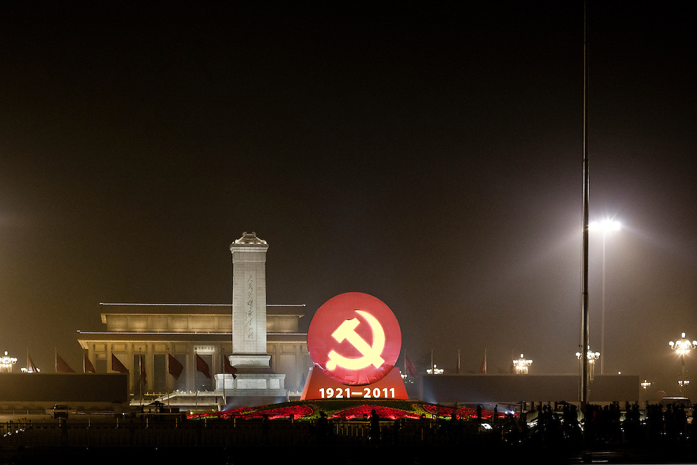 Tiananmen square ready for the CPC 90 years anniversary, with a giant communist symbol specially build. In the background, the Communist heros monument and the Mao's mausoleum.
