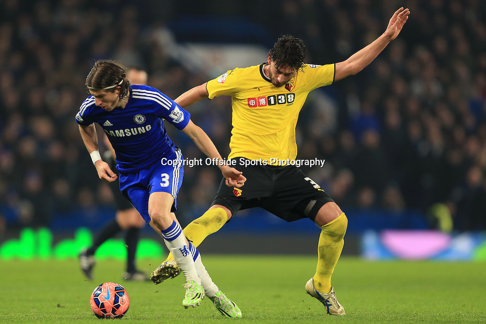4 January 2015 - The FA Cup 3rd Round - Chelsea v Watford - Filipe Luis of Chelsea tangles with Gianni Munari of Watford - Photo: Marc Atkins / Offside.