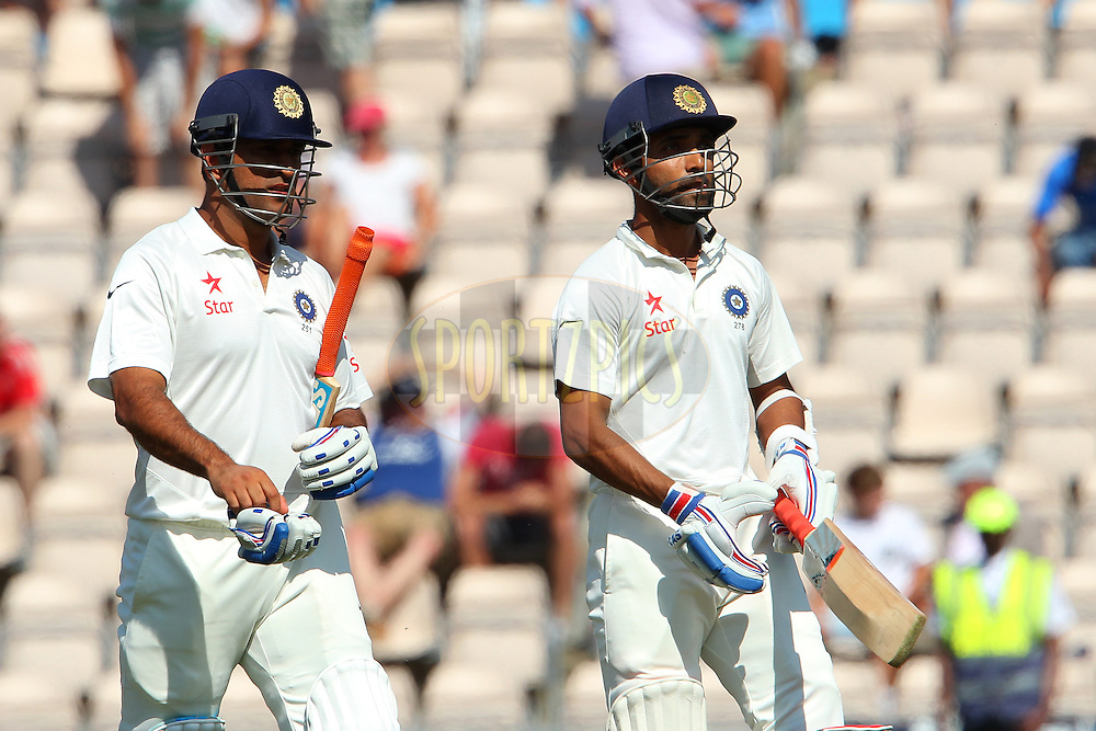 Mahendra Singh Dhoni captain of India and Ajinkya Rahane of India leave for tea during day three of the third Investec Test Match between England and India held at The Ageas Bowl cricket ground in Southampton, England on the 29th July 2014<br /> <br /> Photo by Ron Gaunt / SPORTZPICS/ BCCI