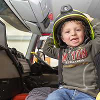 Quinn Berry from Shannon tries on a firemans hat at the Shannon Fire and Rescue Service Open Day held on Saturday