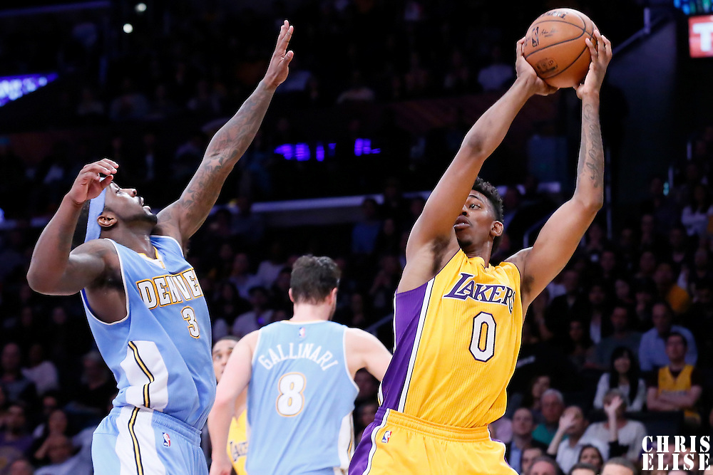 10 February 2015: Los Angeles Lakers forward Nick Young (0) drives past Denver Nuggets guard Ty Lawson (3) during the Denver Nuggets 106-96 victory over the Los Angeles Lakers, at the Staples Center, Los Angeles, California, USA.