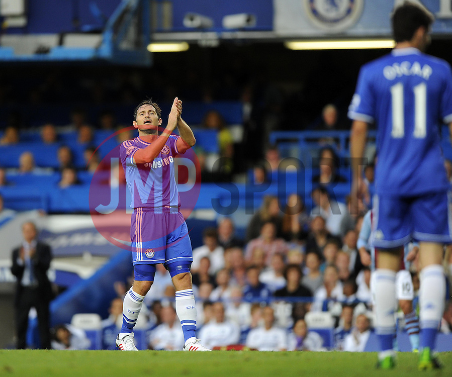 "Chelsea Manager, Jose Mourinho (left) and Chelsea's Frank Lampard (centre) applaud Chelsea's Oscar's (right) effort  - Photo mandatory by-line: Joe Meredith/JMP - Tel: Mobile: 07966 386802 21/08/2013 - SPORT - FOOTBALL - Stamford Bridge - London - Chelsea V Aston Villa - Barclays Premier League - EDITORIAL USE ONLY. No use with unauthorised audio, video, data, fixture lists, club/league logos or ""live"" services. Online in-match use limited to 45 images, no video emulation. No use in betting, games or single club/league/player publications"