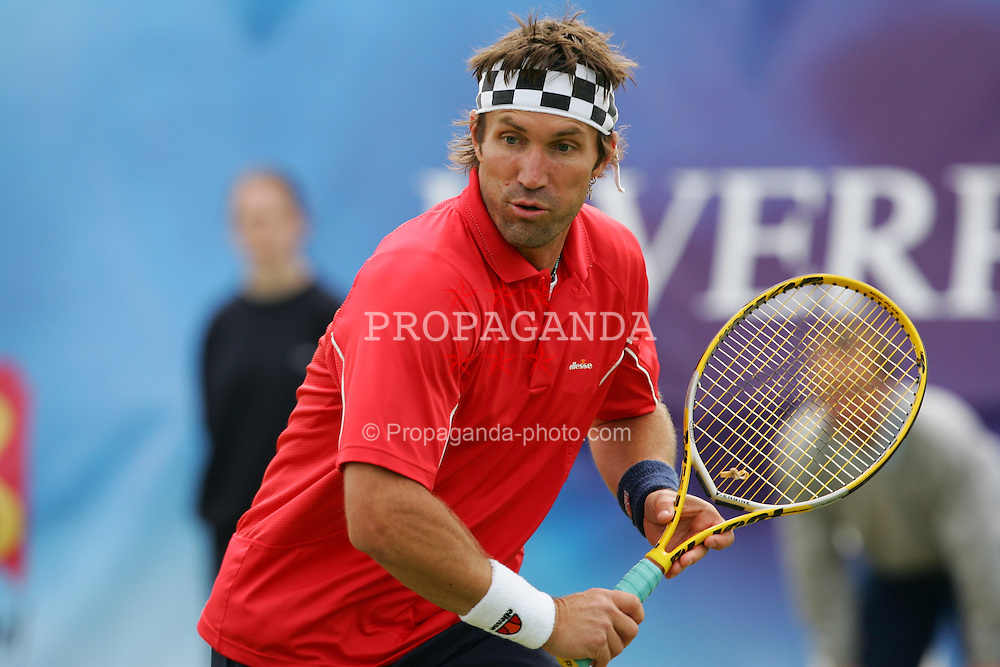 LIVERPOOL, ENGLAND - SUNDAY, JUNE 12th, 2005: Pat Cash in action during an Exhibition match of the Liverbird Developments Liverpool International Tennis Tournament in Calderstones Park. (Pic by David Rawcliffe/Propaganda).