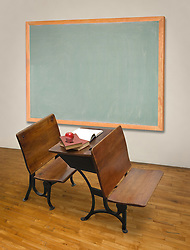 Vintage classroom with antique deskss and chalkboard