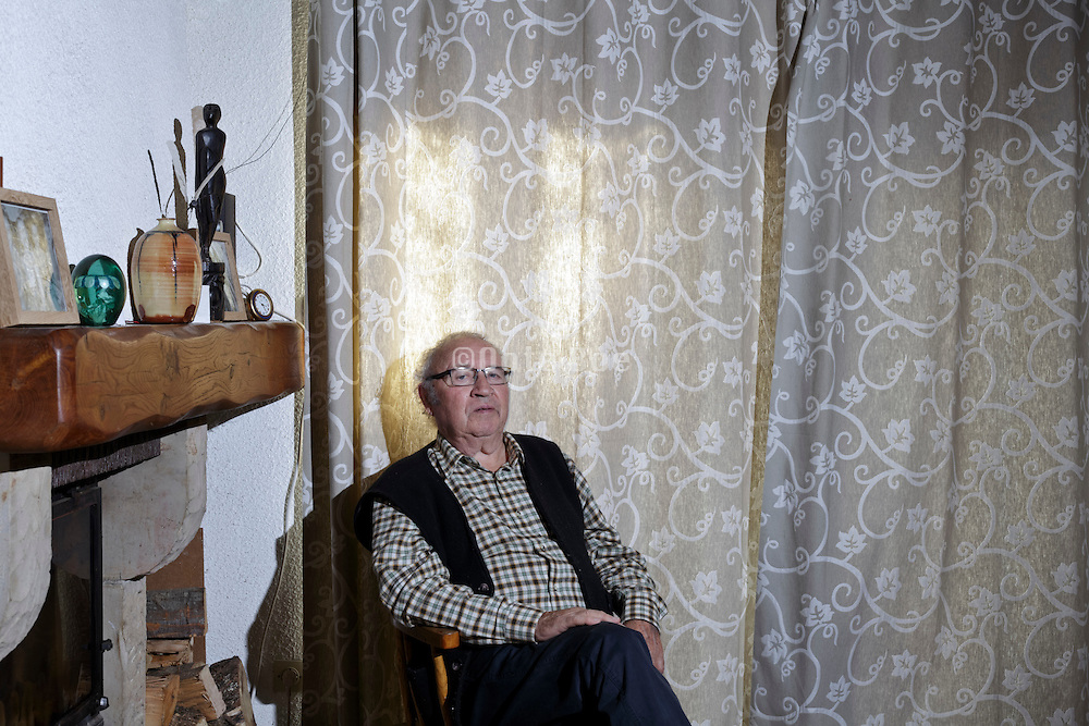 portrait of comfortable sitting 80 + year old man