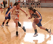 Beavercreek's Kelsie Cooley (31) defends against Miamisburg's Erica Allenspach (22) at the Girls Division I sectional basketball finals, held at Troy High School, Saturday afternoon.