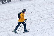 UNITED KINGDOM, London: 01 March 2018 A skier makes his way up the hill as others sled down it on Hampstead Heath this morning. The cold weather and snow is set continue as Storm Emma makes it's way across the country. Rick Findler / Story Picture Agency
