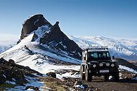 A Land Rover Defender by mountain Einhyrningur. Glacier Eyjafjallajokull in background.<br /> <br /> Land Rover Defender við fjallið Einhyrning. Eyjafjallajökull í baksýn.