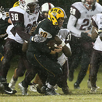 Ripley's Dylan Goolsby is tackled by New Albany's Artavious Nugent during Friday night's game against New Albany.