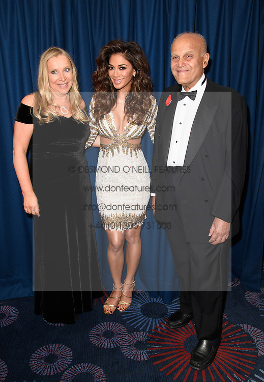 Left to right. EMMA SCANLON. NICOE SCHERZINGER and SIR MAGDI YACOUB at the Chain of Hope Gala Ball held at The Grosvenor House Hotel, Park Lane, London on 18th November 2016.