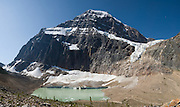 On Mount Edith Cavell, Angel Glacier lies in a cirque above Cavell Glacier and Cavell Pond, in Jasper National Park, Alberta, Canada. Jasper is part of the Canadian Rocky Mountain Parks World Heritage Site declared by UNESCO in 1984. Panorama stitched from 6 images.