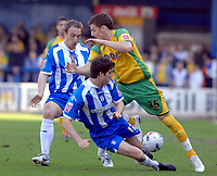 Photo: Ashley Pickering.<br />Colchester United v Norwich City. Coca Cola Championship. 31/03/2007.<br />Chris Martin of Norwich (yellow) tries to get past the Colchester defence