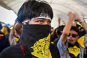 01 SEPTEMBER 2013 - BANGKOK, THAILAND: Students from technical and vocational schools in Bangkok march in support of a Siam Pitak protest in Lumpini Park Sunday. Siam Pitak is one of several groups organized around opposition to the government of Yingluck Shinawatra, the Prime Minister of Thailand and brother of deposed and exiled former Prime Minister Thaksin Shinawatra, the brother of Yingluck. The Siam Pitak protest has been ongoing in Lumpini Park for more than a month.      PHOTO BY JACK KURTZ