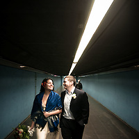 On their wedding day a couple walk the underground system of Barcelona Metro.