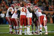 The Kansas City Chiefs offense huddles and calls a play during the NFL week 4 regular season football game against the Denver Broncos on Monday, Oct. 1, 2018 in Denver. The Chiefs won the game 27-23. (©Paul Anthony Spinelli)