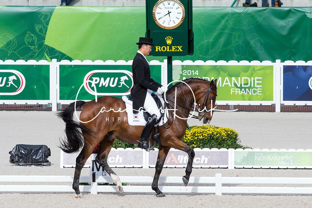 Dong Seon Kim, (KOR), Bukowski - Grand Prix Team Competition Dressage - Alltech FEI World Equestrian Games™ 2014 - Normandy, France.<br /> © Hippo Foto Team - Leanjo de Koster<br /> 25/06/14