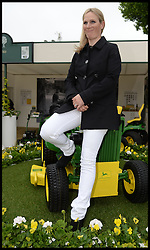 Zara Phillips sits on a John Deere Lawnmower, at the Chelsea Flower Show,to help celebrate 50 years of producing the John Deere lawnmower. Monday, 20th May 2013.Picture by Andrew Parsons / i-Images<br /> File photo - Zara Phillips has given birth to a baby girl<br /> Zara Phillips has given birth to a baby girl at Gloucestershire Royal Hospital.<br /> Her husband and former England rugby player Mike Tindall was present at the birth.<br /> The weight of the baby was 7lbs 12oz, Buckingham Palace announced today.<br /> <br /> Picture filed Friday, 17th January 2014