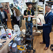 May 3, 2012 - Manhattan, NY : Musician and composer Michael Arenella, at right, chats with haberdasher Brandon Franklin, second from right, as he visits Worth & Worth, a men's and women's hat store located at 45 West 57th St. in Manhattan, on Thursday.  CREDIT : Karsten Moran for The New York Times