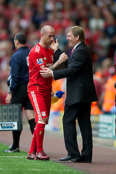 LIVERPOOL, ENGLAND - Saturday, April 23, 2011: Liverpool's manager Kenny Dalglish and Raul Meireles during the Premiership match against Birmingham City at Anfield. (Photo by David Rawcliffe/Propaganda)