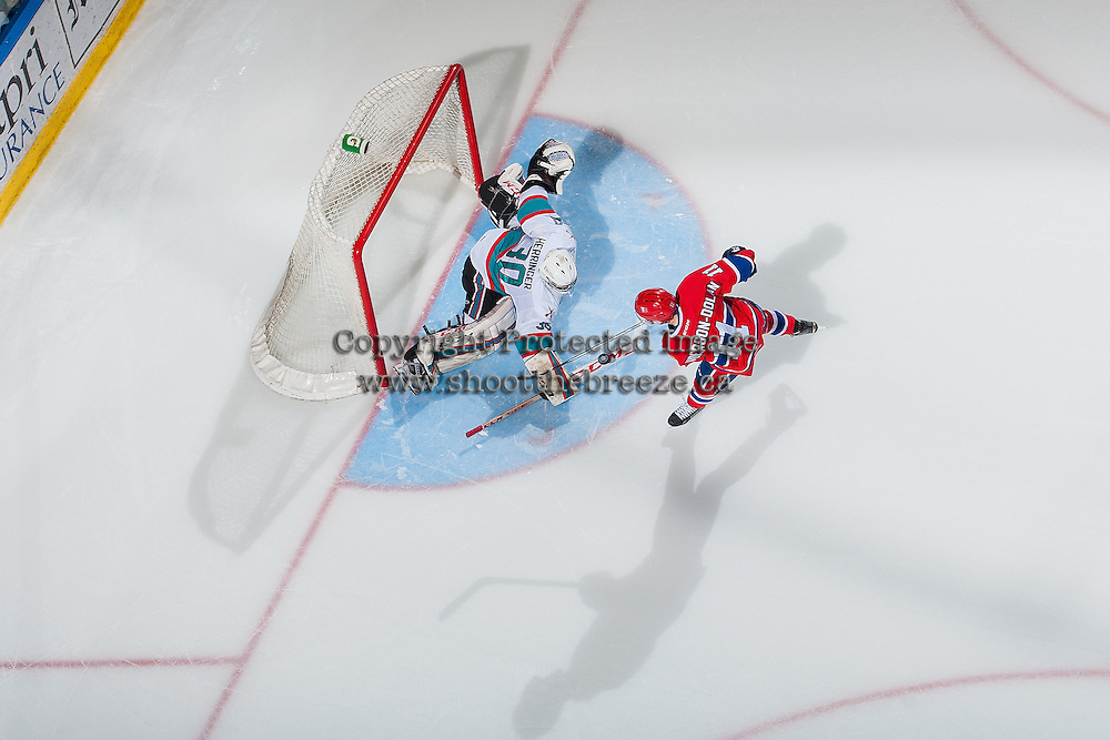 KELOWNA, CANADA - FEBRUARY 27: Michael Herringer #30 of Kelowna Rockets makes a save during the shoot out on a shot from Jaret Anderson-Dolan #11 of Spokane Chiefs on February 27, 2016 at Prospera Place in Kelowna, British Columbia, Canada.  (Photo by Marissa Baecker/Shoot the Breeze)  *** Local Caption *** Jaret Anderson-Dolan; Michael Herringer;