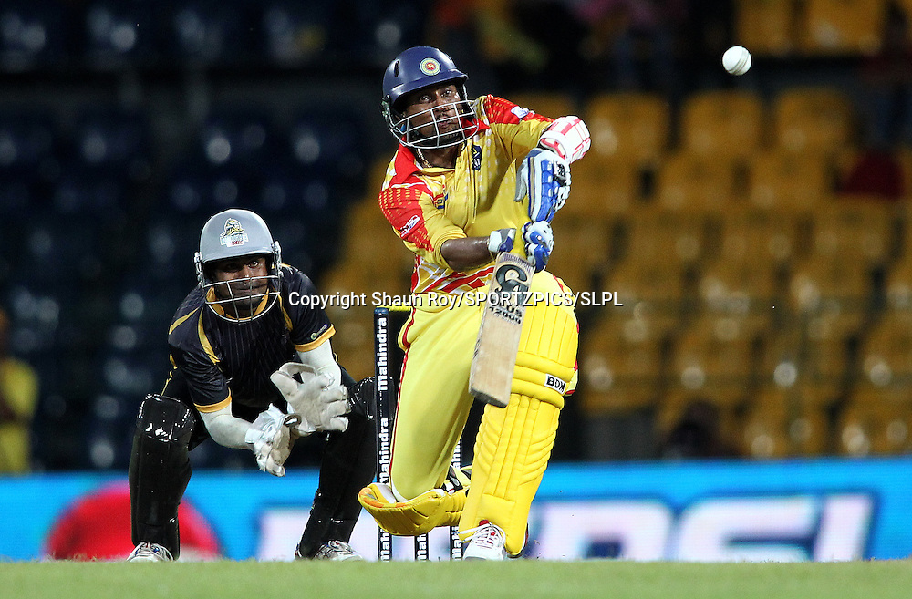 Basnahira Cricket Dundee captain Tillakaratne Dilshan attempts to scoop a delivery during match 2 of the Sri Lankan Premier League between Basnahira and Kandurata held at the Premadasa Stadium in Colombo, Sri Lanka on the 11th August 2012<br />  <br /> Photo by Shaun Roy/SPORTZPICS/SLPL