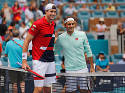 Roger Federer, of Switzerland, and John Isner, of the United States, pose before the final of the Miami Open tennis tournament at Hard Rock Stadium on Sunday, March 31, 2019, in Miami Gardens, Fla. Roger Federer won 6-1, 6-4. Photo by David Santiago/Miami Herald/TNS/ABACARESS.COM