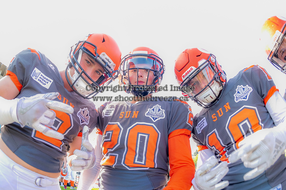 KELOWNA, BC - AUGUST 3:  Garrett Cape #2, Tyler Going #20 and Conor Richard #10 of Okanagan Sun ham it up for the camera prior to the start of home opener against the Kamloops Broncos at the Apple Bowl on August 3, 2019 in Kelowna, Canada. (Photo by Marissa Baecker/Shoot the Breeze)