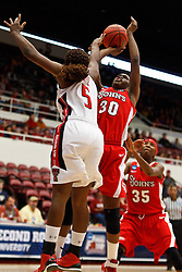 March 19, 2011; Stanford, CA, USA; St. John's Red Storm forward Centhya Hart (30) shoots over Texas Tech Lady Raiders guard Christine Hyde (5) during the first half of the first round of the 2011 NCAA women's basketball tournament at Maples Pavilion. St. John's defeated Texas Tech 55-50.