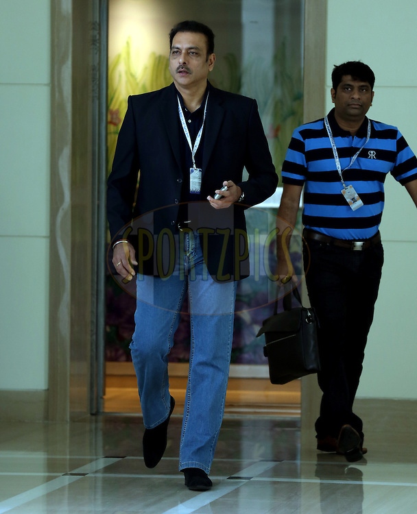 Ravi Shastri Walks in before the  Pepsi IPL Player Auction held at the ITC Gardenia in Bengaluru, India on the 13th February 2014<br /> <br /> Photo by Sandeep Shetty/BCCI/SPORTZPICS