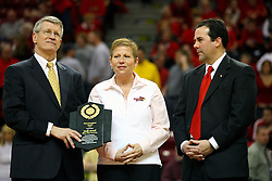 "31 January 2009: Missouri Valley Commissioner Doug Elgin presents Molly Arnold with the conferences Most Courageous Award.  Illinois State Athletic Director Sheahon Zenger stands on Molly's left.  Molly battle cancer. The Illinois State University Redbirds join the Bradley Braves in a tie for 2nd place in ""The Valley"" with a 69-65 win on Doug Collins Court inside Redbird Arena on the campus of Illinois State University in Normal Illinois"