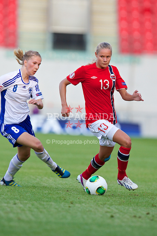 LLANELLI, WALES - Thursday, August 22, 2013: Norway's Andrine Tomter in action against Finland's Erika Winter during the Group B match of the UEFA Women's Under-19 Championship Wales 2013 tournament at Parc y Scarlets. (Pic by David Rawcliffe/Propaganda)