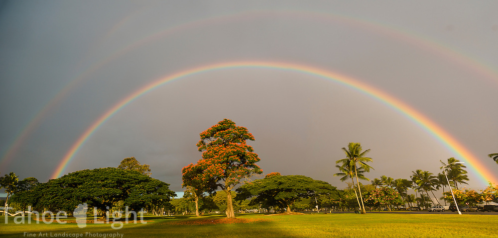 Rainbow over the Japanese gardens in Hilo, where a clock stands stopped at 1:04 am. After a second devastating Tsunami struck here with a 20 foot wave at 1:04 am in 1960, the state prohibited residential rebuilding in the twice affected areas, turning much of the land into public parks.
