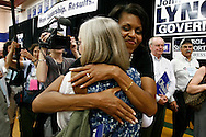 Michelle Obama, wife of Democratic presidential hopeful Senator Barack Obama, greets to supporters during a rally in Concord, New Hampshire June, 2, 2007. .