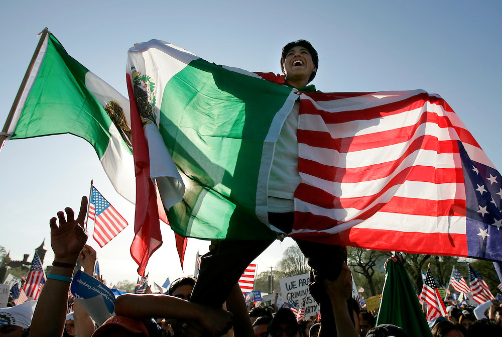 A man holds American and Mexican flags during the ìNational Day of Action for Immigrant Justiceî rally on the National Mall in Washington, DC, Monday 10 April 2006. The demonstration coincided with similar rallies across the United States that voiced opposition to a US House of Representatives bill that would make illegal entry into the US a crime and step up the building of a barrier on the US-Mexico border. Efforts in the Senate to reach a compromise, which would open the way for undocumented workers to be legalized, collapsed last week.