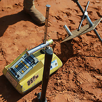 A small device is used to measure the denisty of the soil along Ida Street to make sure the ground can support the foundations.