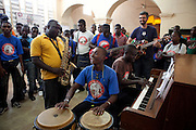 Teachers gather for an impromptu jam session following daily classes. The mood is fun and creative, and various students join in.