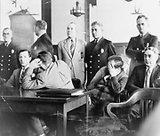 Louis 'Lepke' Buchalter, facing front, seated with Emanuel 'Mendy' Weiss and Phillip 'Little Farvel' Cohen who shield their faces, as well as Louis Capone, in a Kings County Courtroom during jury selection, 1941.