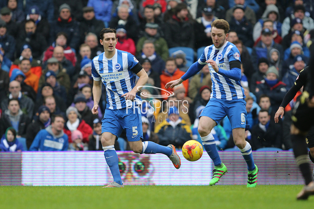 Brighton central midfielder, Dale Stephens (6) watched by Brighton central defender, Lewis Dunk (5) during the Sky Bet Championship match between Brighton and Hove Albion and Bolton Wanderers at the American Express Community Stadium, Brighton and Hove, England on 13 February 2016. Photo by Geoff Penn.