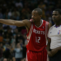 Rafer Alston #12 of the Houston Rockets argues a call with NBA official Leroy Robinson in the fourth quarter of their NBA game against the New Orleans Hornets on March 19, 2008 at the New Orleans Arena in New Orleans, Louisiana.