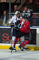 KELOWNA, CANADA - MARCH 9: Jermaine Loewen #32 of the Kamloops Blazers checks Dalton Gally #3 of the Kelowna Rockets on March 9, 2019 at Prospera Place in Kelowna, British Columbia, Canada.  (Photo by Marissa Baecker/Shoot the Breeze)