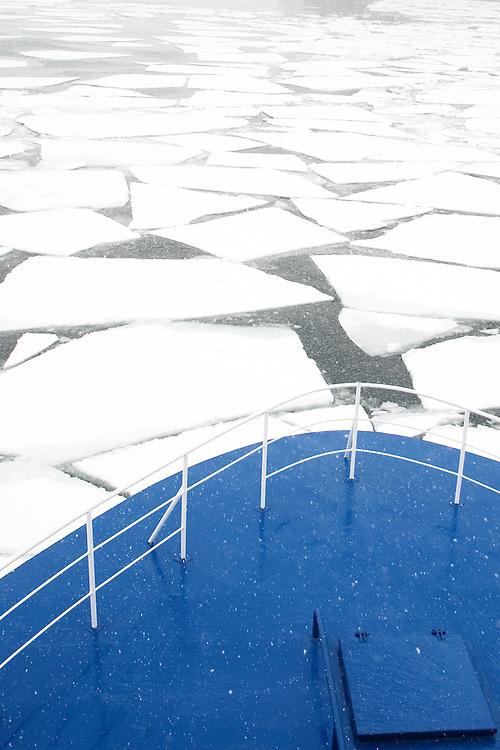 Antarctica. Ocean Nova breaks through sea ice in the Drake Passage.