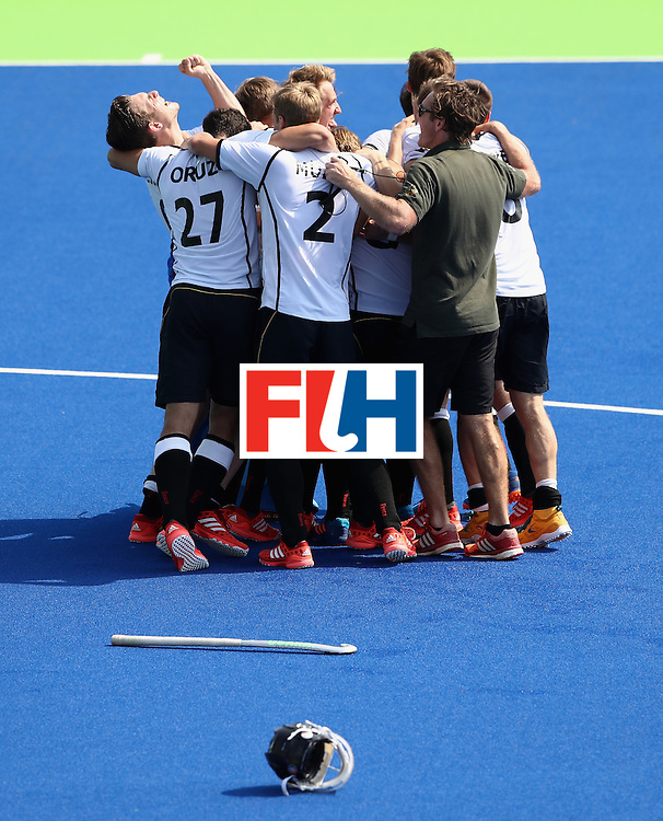 RIO DE JANEIRO, BRAZIL - AUGUST 18:  Nicolas Jacobi the Germany goalkeeper is mobbed by team mates after saving the shot from Sander de Wijn to win the penalty shoot out during the Men's Bronze Medal match between the Netherlands and Germany on Day 13 of the Rio 2016 Olympic Games held at the Olympic Hockey Centre on August 18, 2016 in Rio de Janeiro, Brazil.  (Photo by David Rogers/Getty Images)