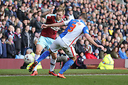 Burnley midfielder Scott Arfield  goes past Blackburn Rovers defender Tommy Spurr (3)  during the Sky Bet Championship match between Burnley and Blackburn Rovers at Turf Moor, Burnley, England on 5 March 2016. Photo by Simon Davies.