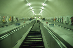 Escalator in tube station; London,