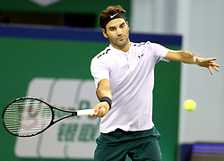 Oct. 14, 2017 - Shanghai, China - Roger Federer of Switzerland hits a return during the singles semifinal match against J. Martin del Potro of Argentina at 2017 ATP Shanghai Masters tennis tournament in Shanghai. (Credit Image: © Fan Jun/Xinhua via ZUMA Wire)